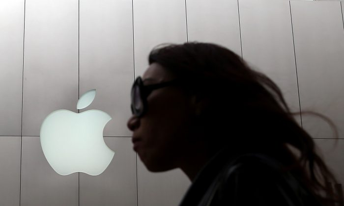 A pedestrian walks by an Apple Store in San Francisco, Calif., on on July 10, 2013. (Justin Sullivan/Getty Images)