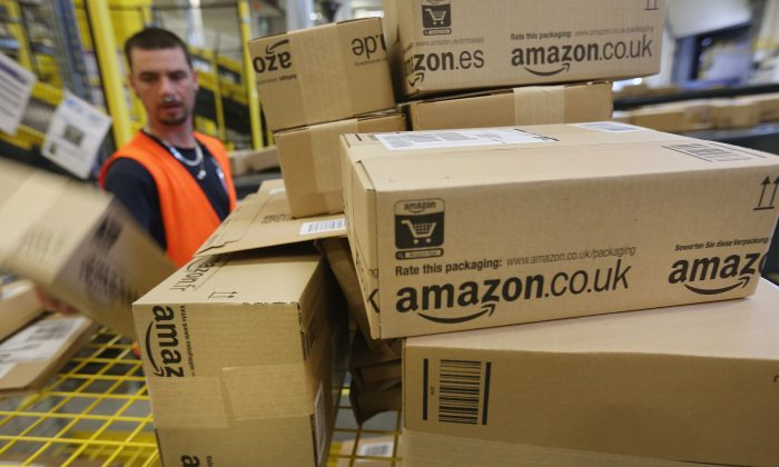 A worker prepares packages for delivery at an Amazon warehouse on September 4, 2014 in Brieselang, Germany.  (Sean Gallup/Getty Images)