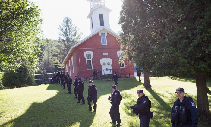 Law enforcement personnel prepare to head out on a search for convicted murderers Richard Matt and David Sweat continues on June 26, 2015 in Chasm Falls, New York. Matt and Sweat were discovered missing from a prison in nearby Dannemora on June 6. DNA from the two was reportedly found recently in a remote hunting cabin about 15 miles west of the prison. (Scott Olson/Getty Images)