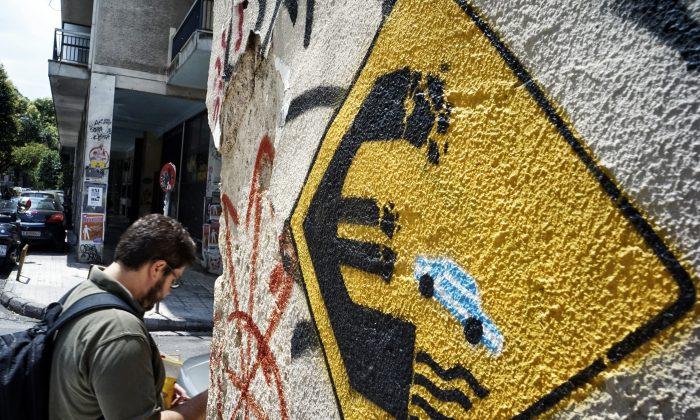 A man walks past anti-EU graffiti on June 30, 2015 in Athens, Greece. (Milos Bicanski/Getty Images)
