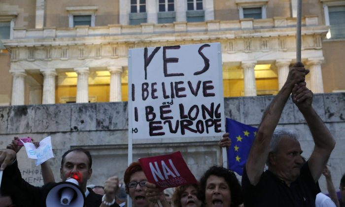 Supporters of the YES vote at a rally in front of the Greek Parliament in Athens on Tuesday. (AP Photo/Petros Karadjias)