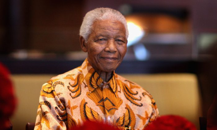 Nelson Mandela smiles during a lunch to Benefit the Mandela Children's Foundation as part of the celebrations of the opening of the new One&Only Cape Town resort on April 3, 2009 in Cape Town, South Africa.(Chris Jackson/Getty Images)