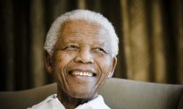 Nelson Mandela on Life Support as Emotion in S. Africa Builds