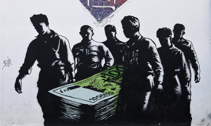 "A graffiti artwork titled ""Death of Euros"" by French street artist Goin at the Athens School of Fine Arts, on June 17, 2015. Over the past five years of Greece's economic depression, more and more paintings commenting on the country's financial and social woes have appeared. (Petros Giannakouris/AP)"