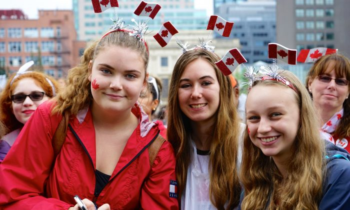 These three young women were among the many who celebrated Canada on Parliment Hill on July 1, the country's 148th birthday. (Pam McLennan/Epoch Times)