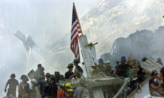 In this Sept. 13, 2001 file photo, a U.S. flag flies over the rubble of the collapsed World Trade Center buidlings in New York. (AP Photo/Beth A. Keiser)