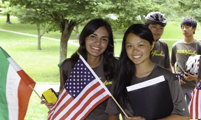 Global Ambassadors, Ghazal Tavanael from Iran and Annie Chen from the USA at a Ride2Freedom rally at Lawrence, Kan., on June 26, 2015.  (Chris Jasurek/Epoch Times)