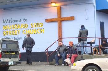 HARD TIMES: People gather outside the Mustard Seed food bank in Victoria. Close to 800,000 people used a food bank in March 2009, an increase of almost 120,000 people compared to the same time last year.  (Joan Delaney/The Epoch Times)