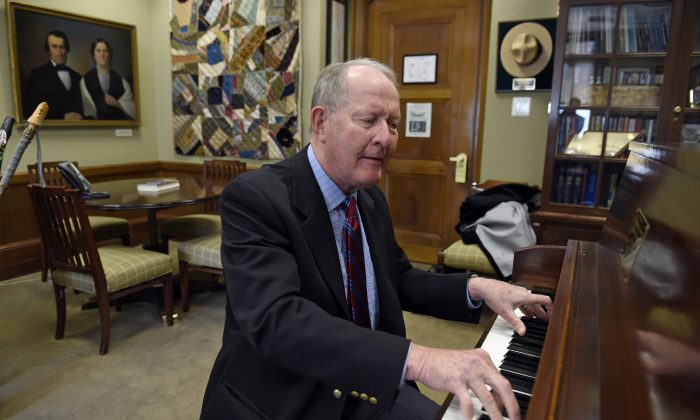 "Sen. Lamar Alexander, R-Tenn., plays piano in his office on Capitol Hill in Washington, Friday, May 22, 2015. Alexander, who had the piano delivered to his Capitol Hill office so he could practice, is slated to deliver a sunset piano performance of ""Ol' Man River"" on the banks of the Mississippi River with the Memphis Symphony Orchestra Saturday. But the Senate's slow-motion amble toward Memorial Day break threatens all that. (AP Photo/Susan Walsh)"