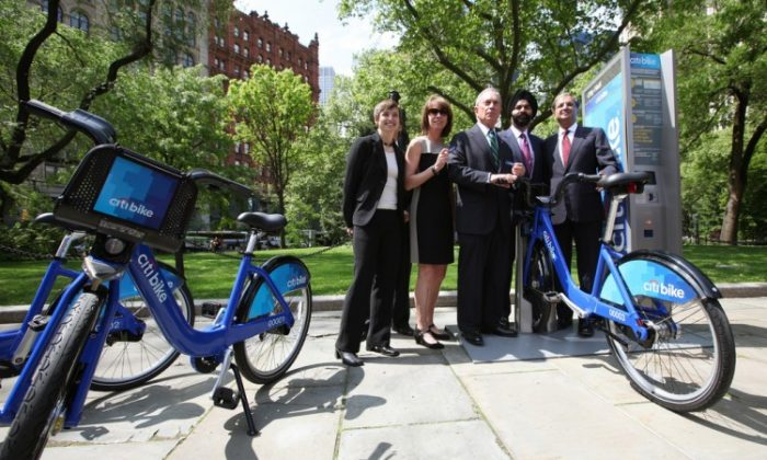 "(From L to R) Alison Cohen, president of Alta Bicycle Share; Janette Sadik-Khan, NYC Department of Transportation commissioner; Mayor Micheal Bloomberg; Ajay Banga, president and CEO of MasterCard; and Vikram Pandit, Citi CEO, announced on Monday that Citi will be the title sponsor, and Mastercard the payment sponsor, for New York City's new bike share program, ""Citi Bike."" (Edward Reed/NYC Mayor's Office)"
