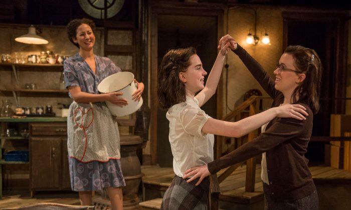 "A happy moment when 13-year-old Anne (Sophie Thatcher) dances with her older sister Margot (Lila Morse) while her mother Edith Frank (Kristina Valada-Vlars) watches, in the current Writers Theatre production of ""The Diary of Anne Frank.""  (Michael Brosilow)"