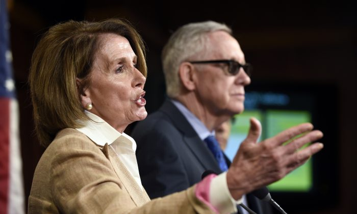FILE - In this June 25, 2015, file photo, House Minority Leader Nancy Pelosi of Calif. (L) accompanied by Senate Minority Leader Harry Reid of Nev. speaks during a news conference on Capitol Hill in Washington. (AP Photo/Susan Walsh, File)