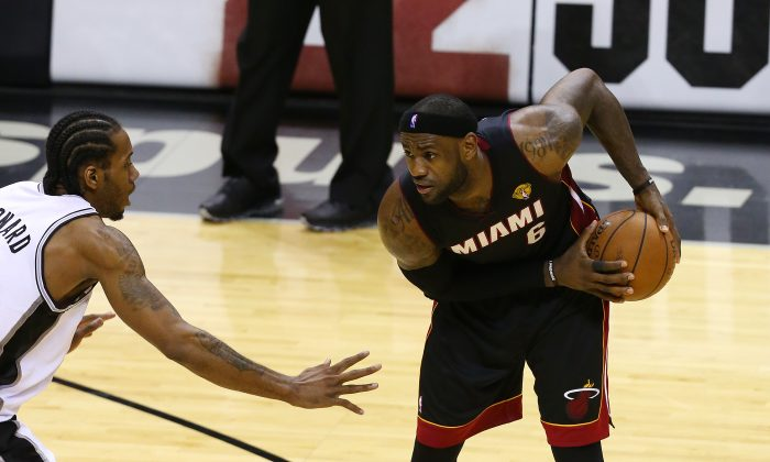 When LeBron James (R) joined the Miami Heat in 2010, they became instant title contenders while his former Cleveland team fell to the bottom of the league. (Chris Covatta/Getty Images)