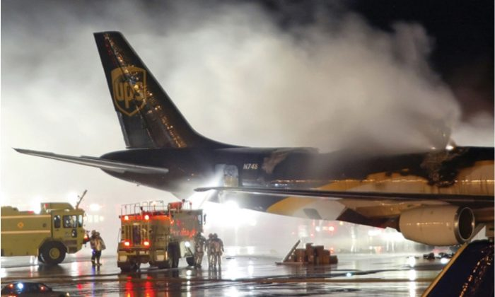 An emergency crew arrives on the scene where  a UPS 747-400 Boeing cargo plane caught fire due to lithium ion batteries  in Dubai on Sept. 5, 2010. (Courtesy of Federal Aviation Administration)
