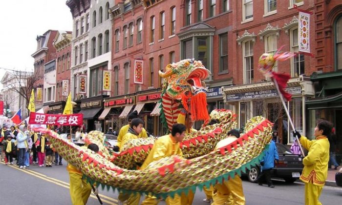 """Hon-Yuen Wong, now head of the DC Chinese New Year parade committee, in 2005 presented an award to Sen Nieh, a professor and practitioner of Falun Gong, for """"earnestly serving the community."""" Nieh says that Falun Gong hasn't changed, but that some members of the community have been influenced by the Chinese Embassy. (The Epoch Times)"""