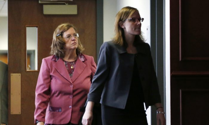 In this Dec. 8, 2014 file photo, Arlene Holmes, left, mother of James Holmes who is charged in the killing of 12 moviegoers and the wounding of 70 others in a shooting spree in a crowded theatre in Aurroa, Colo., on July 20, 2012, leaves the courtroom after a pre-trial readiness hearing in Centennial, Colo., in the murder trial of her son. After more than two months of testimony in the trial, new details have been revealed to show the strained relationship that had developed between Holmes, his parents and sister leading up to the massacre in the theatre.  (AP Photo/David Zalubowski)