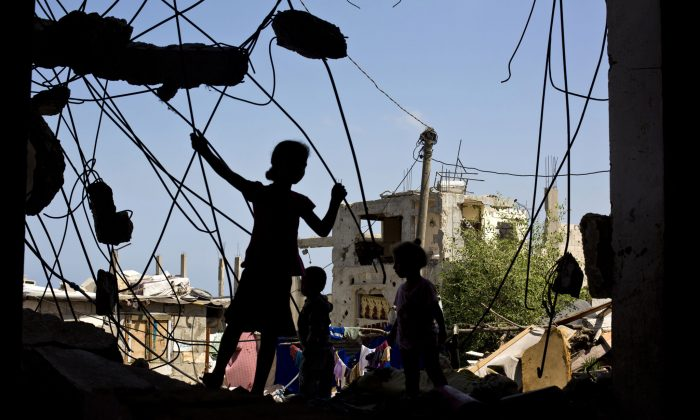 Palestinian children play on July 2, 2015, in the rubble of a building that was destroyed during the 50-day war between Israel and Hamas' militants in the summer of 2014, in the al-Shejaeiya neighbourhood, east of Gaza City. (Mohammed Abed/AFP/Getty Images)