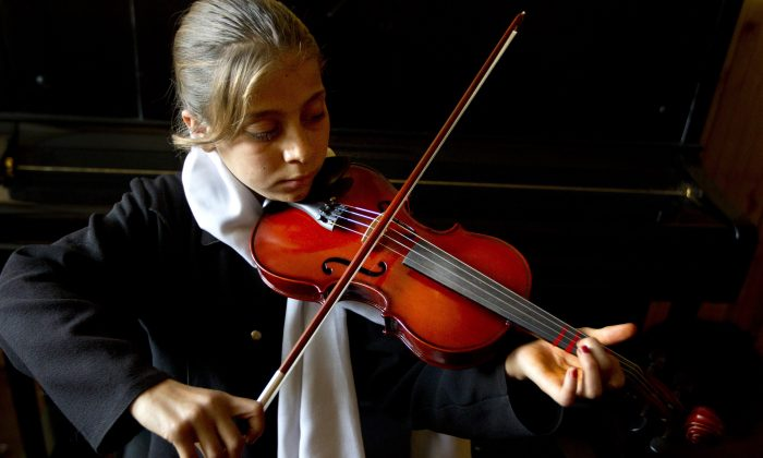 Musical training has been shown to lead to improvements in a wide variety of different skills, including memory and spatial learning for example. (Paula Bronstein /Getty Images)