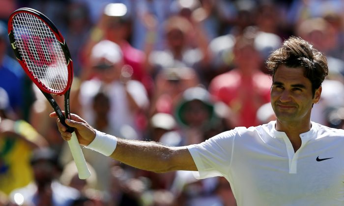 Switzerland's Roger Federer celebrates beating Australia's Samuel Groth during their men's singles third round match on day six of the 2015 Wimbledon Championships at The All England Tennis Club in Wimbledon, southwest London, on July 4, 2015. Federer won 6-4, 6-4, 6-7, 6-2. (Justin Tallis/AFP/Getty Images)