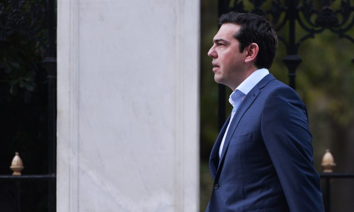 Greek Prime Minister Alexis Tsipras leaves the presidental palace after a swearing in ceremony of the new finance minister Euclid Tsakalotos on July 6, 2015. (Louisa Gouliamaki/AFP/Getty Images)
