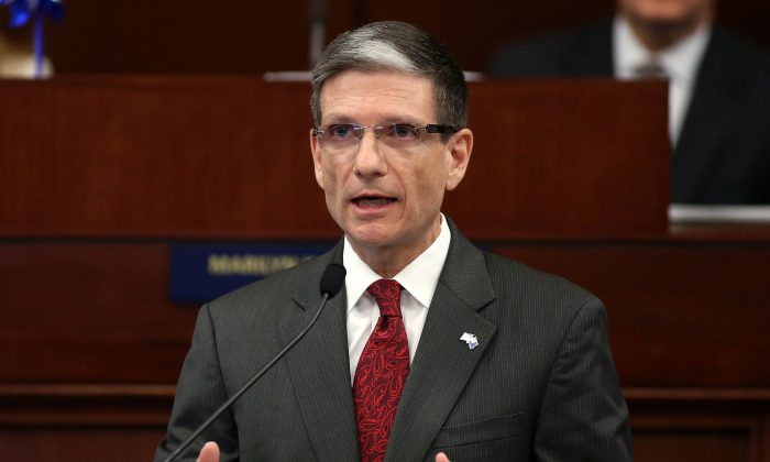 This April 3, 2013 file photo shows U.S. Rep. Joe Heck, R-Nevada, speaks to a joint session of the Legislature in Carson City, Nev. Heck on Monday, July 6, 2015 entered the race for the U.S. Senate seat being vacated by Nevada Democrat Harry Reid, setting in motion what could be one of the top Senate races of 2016. (AP Photo/Cathleen Allison)