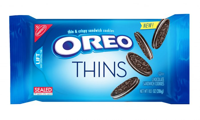"""This product image provided by Mondelez shows the packaging design for """"Oreo Thins."""" Mondelez International Inc. says it will add """"Oreo Thins,"""" which have a similar cookie-to-filling ratio as regular Oreos, except that they're slimmer, to its permanent lineup in the U.S. starting next week. (Mondelez via AP)"""