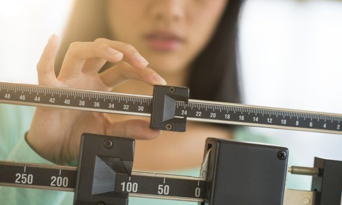 A stock photo of a scale (tetmc/iStock)