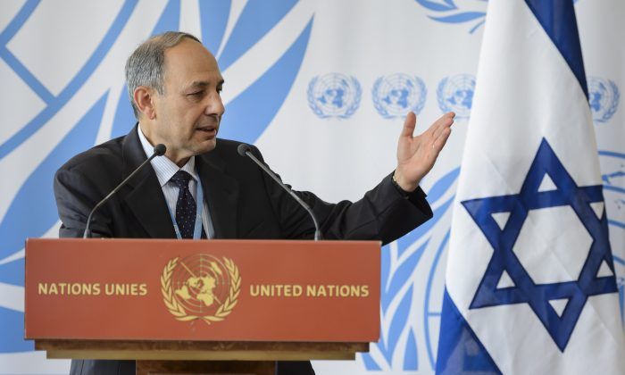 The permanent representative of Israel to the United Nations office in Geneva, Eviatar Manor, gestures during a press conference on June 29, 2015, following a session of the Human Right Council on the report of the Commission of Inquiry on the 2014 Gaza conflict. (Fabrice Coffrini/AFP/Getty Images)