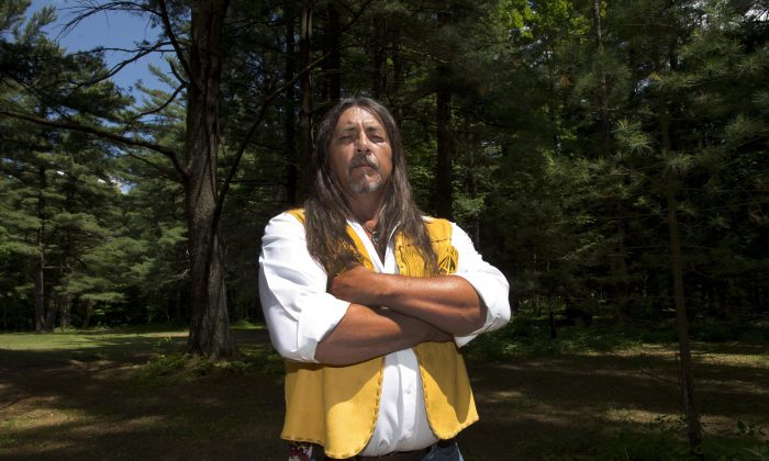 Kanesatake Grand Chief Serge Simon stands in the Pines on June 18, 2015 in Kanesatake, Que., near the scene of the police raid 25 years ago that started the Oka Crisis. July 11, 2015, will mark the 25th anniversary of the start of the Oka Crisis. (The Canadian Press/Ryan Remiorz)
