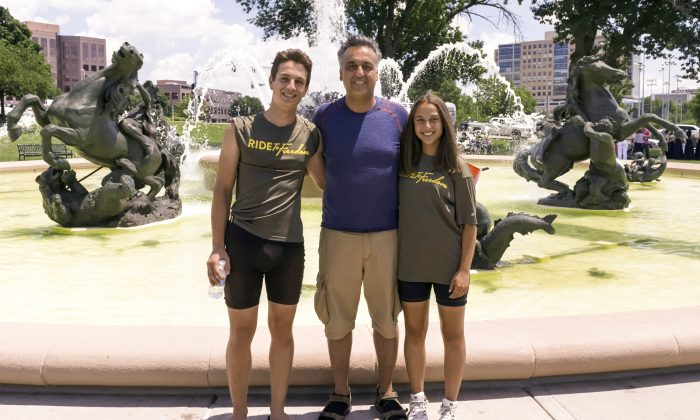 Pasdar family at the Country Club Plaza, KCMO on June 27, 2015. Arian (left), Reza and Anahita Pasdar from Austria on Day 27.  (Cat Rooney/Epoch Times)