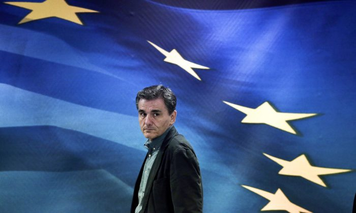 Newly appointed Greek Finance Minister Euclid Tsakalotos arrives for a handover ceremony at the Finance Ministry in Athens on July 6, 2015. (Angelos Tzortzinis/AFP/Getty Images)