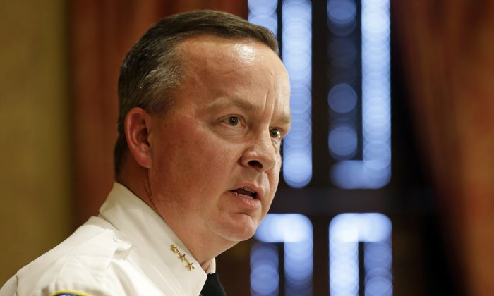 Interim Baltimore Police Department Commissioner Kevin Davis speaks at a news conference, Wednesday, July 8, 2015, in Baltimore, after Mayor Stephanie Rawlings-Blake announced her firing of Commissioner Anthony Batts. (AP Photo/Patrick Semansky)