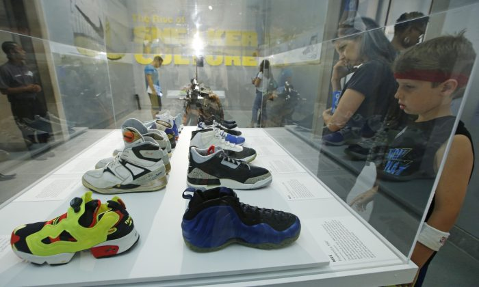 """An array of colorful sneakers are displayed at """"Out of the Box: The Rise of Sneaker Culture"""" exhibit at the Brooklyn Museum of Art in New York, Wednesday, July 8, 2015. (AP Photo/Kathy Willens)"""