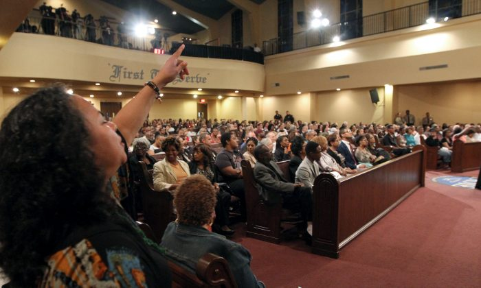 Call and response at the congregation at First AME Church in Los Angeles, June 18. The gathering was to honor the lives lost in Charleston, S.C., on June 17. (Clayton Everett)