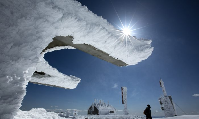 Rime ice coats the buildings and antennas on top of Mt. Washington, Saturday, March 30, 2013, in New Hampshire. (AP Photo/Robert F. Bukaty)