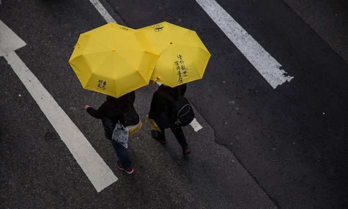 Pro-democracy protesters hold yellow umbrellas during a march for democracy on Feb. 1, 2015 in Hong Kong. (Lam Yik Fei/Getty Images)