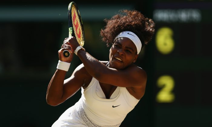 Serena Williams of the United States plays a backhand in the Ladies Singles Semi Final match against Maria Sharapova of Russia during day ten of the Wimbledon Lawn Tennis Championships at the All England Lawn Tennis and Croquet Club on July 9, 2015 in London, England. (Clive Brunskill/Getty Images)