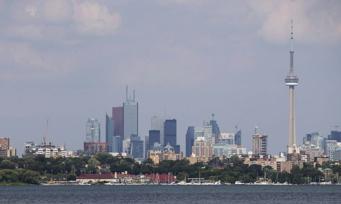 The Toronto skyline on July 17, 2013. Pauline Lierman, director of market research at Urbanation, says the supply of condos has dropped this year in the downtown core, with currently just a 5- to 6-month supply. (The Canadian Press/Michelle Siu)