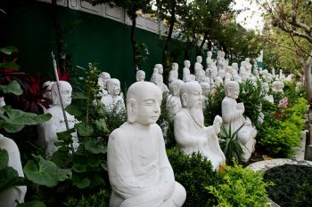 BUDDHA AND NATURE: This garden hosts 1,000 white Buddha statues at Fo Guang Shan monastery. (Rich Carlson)