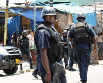 Jamaica Attacks: Police patrol on May 24 in Kingston, Jamaica, after two police officers were killed after coming under attack amid spreading unrest. A state of emergency was declared by the Prime Minister. (Anthony Foster/AFP/Getty Images)