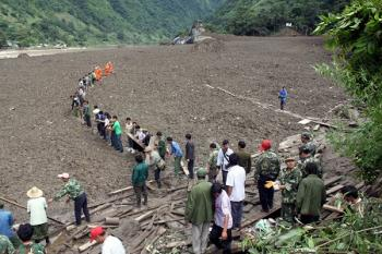 A large and sudden mudslide, close to 1,000 feet in width, hit Yunan Province in China's southwest on Aug. 18 (Epoch Times photo achives )