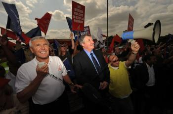 Joint general secretaries of the Unite union, Tony Woodley (L) and Derek Simpson (C) address striking British Airways cabin crew on the third day of a five-day strike near Heathrow Airport, in west London on May 26, 2010. (Ben Stansall/AFP/Getty Images)