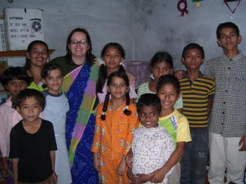 Sue van Schreven (fifth from left) is surrounded by happy children as she continues her work with Orphans Aid International. (Photo Courtesy of Sue van Schreven)