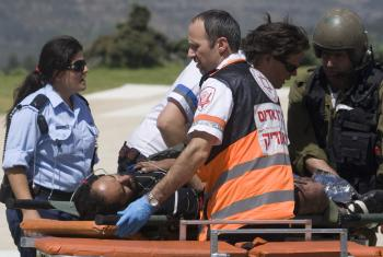 A pro-Palestinian activist is evacuated to Hadassah Ein Kerem Hospital in Jerusalem after Israeli navy seals stormed a boat carrying humanitarian aid to the Gaza Strip against an Israeli blockade. (Ahad Gharabli/AFP/Getty Images)