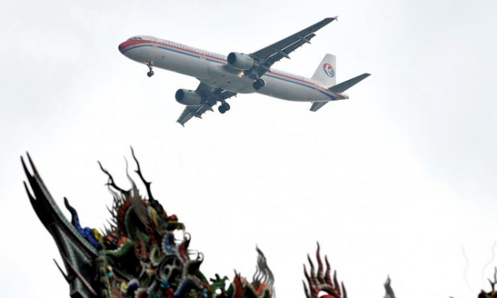 A China Eastern Airlines jet flies over a temple before landing in Taipei on June 29, 2010. Zeng Qinghong laundered money through the airlines to Taiwan in 2002. (Patrick Lin/AFP/Getty Images)