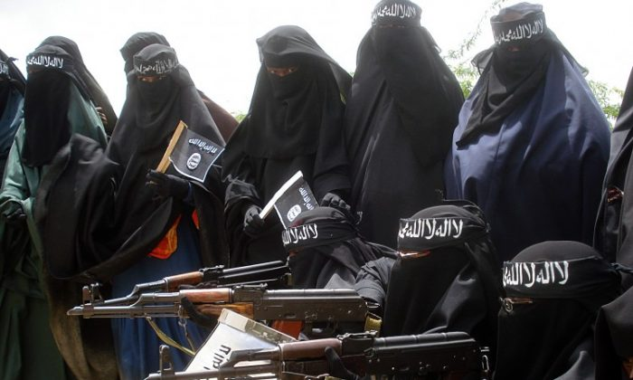 Somali women carry weapons during a demonstration organized by the islamist Al-Shabaab group which is fighting the Somali government in Suqa Holaha neighborhood of Mogadishu in 2010. (Abdurashid Abikar/AFP/Getty Images)