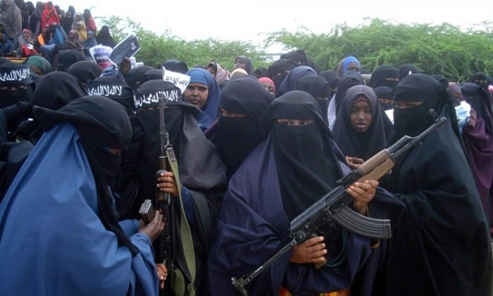 Somali women carry weapons during a demonstration organized by the Islamist Al-Shabaab group in 2010. (Abdurashi Abikar/AFP/Getty Images)