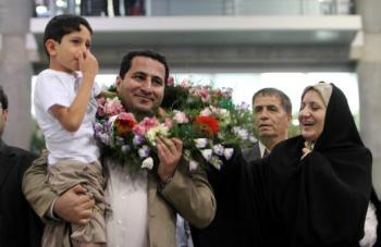 Iranian nuclear scientist Shahram Amiri is welcomed by family members upon his arrival at Imam Khomeini Airport in Tehran on July 15. Amiri claimed he was subjected to �¢ï¿½ï¿½mental and physical torture�¢ï¿½ï¿½ by the CIA. (Atta Kenare/Getty Images)