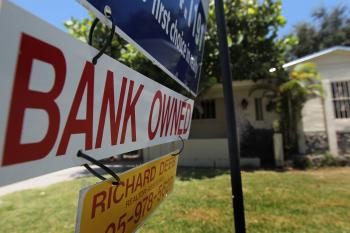 A bank owned sign is seen in front of a foreclosed home July 29, 2010 in Miami, Florida. (Joe Raedle/Getty Images)