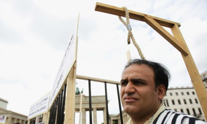 Demonstrators protest against executions in Iran on August 13, 2010 in Berlin. (Andreas Rentz/Getty Images)